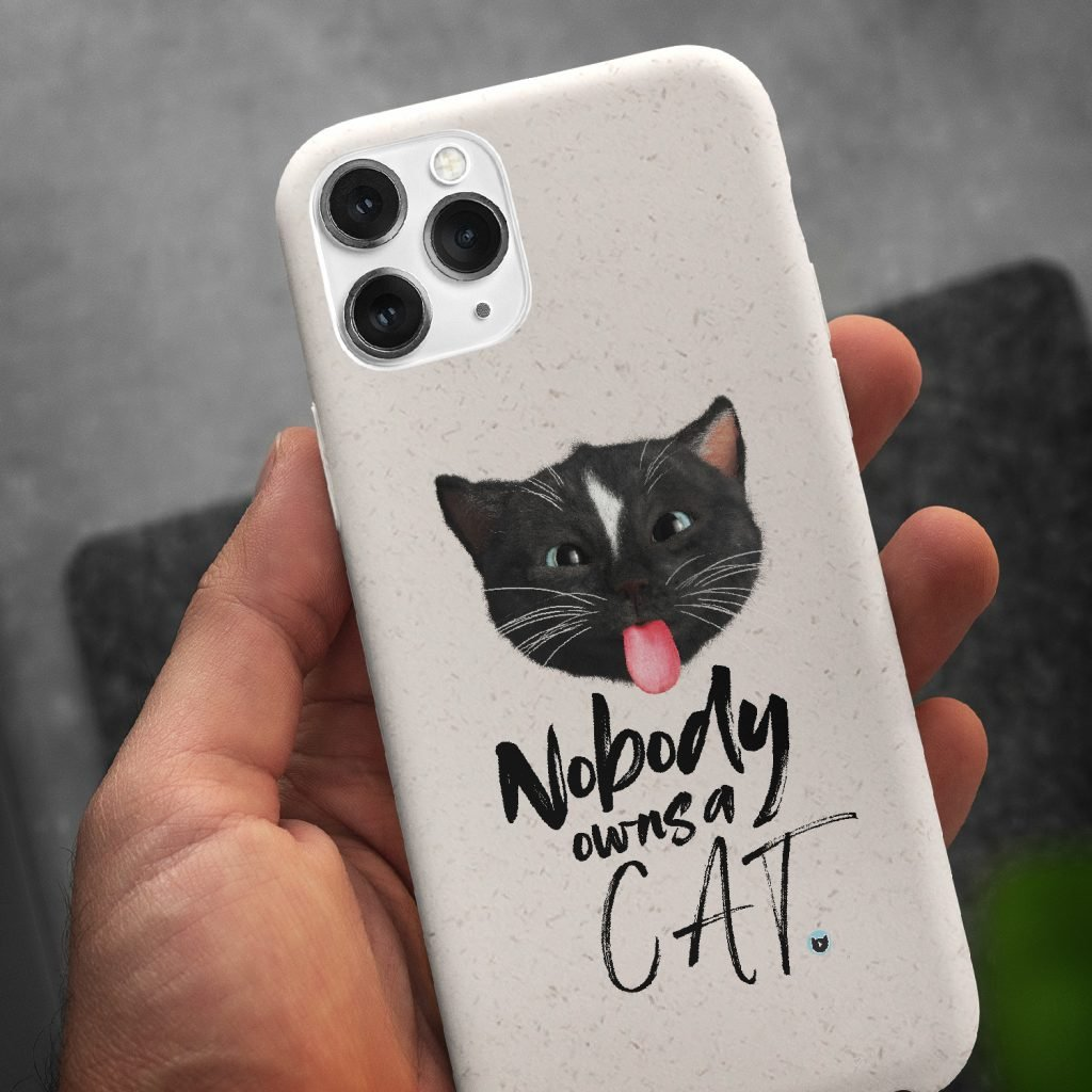 Biodegradable Phone Case With Felini the Kitty Cat sticking the tongue out saying Nobody Owns a cat!